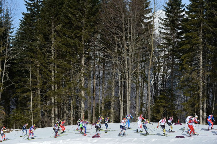 Competitors take part in the Men's Cross-Country Skiing 50km Mass Start Free at the Laura Cross-Country Ski and Biathlon Center during the Sochi Winter. (ALBERTO PIZZOLI/AFP/Getty Images)