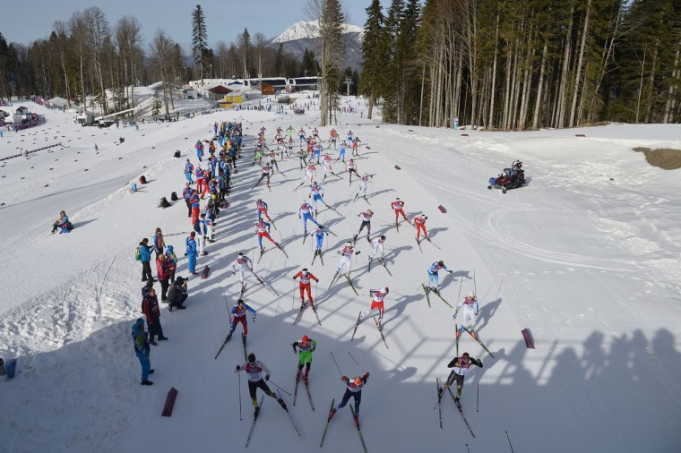 Athletes compete in the Men's Cross-Country Skiing 50km Mass Start Free at the Laura Cross-Country Ski. (ALBERTO PIZZOLI/AFP/Getty Images)