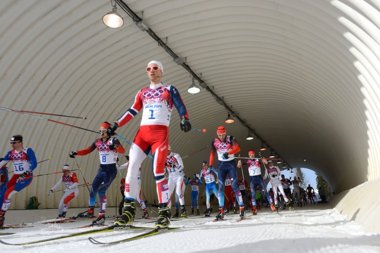 Czech Republic's Lukas Bauer (16), Russia's Ilia Chernousov (8) and Norway's Martin Johnsrud Sundby (1) compete in the Men's Cross-Country Skiing 50km Mass Start Free. (KIRILL KUDRYAVTSEV/AFP/Getty Images)