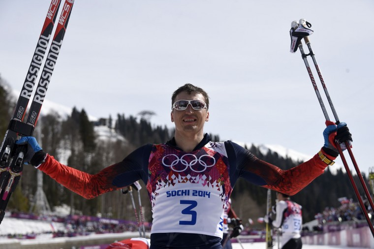 Gold medalist Russia's Alexander Legkov (3) celebrates at the finish line in the Men's Cross-Country Skiing 50km Mass Start Free. (ODD ANDERSEN/AFP/Getty Images)