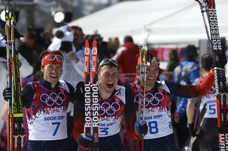 Silver medalist Russia's Maxim Vylegzhanin (7) gold medalist Russia's Alexander Legkov (3) and Bronze medalist Russia's Ilia Chernousov (8) celebrate at the finish line in the Men's Cross-Country Skiing 50km Mass Start Free. (PIERRE-PHILIPPE MARCOU/AFP/Getty Images)