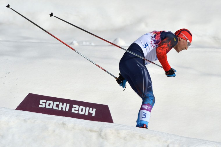 Gold medalist Russia's Alexander Legkov (3) skis to the finish line in the Men's Cross-Country Skiing 50km Mass Start Free at the Laura Cross-Country Ski and Biathlon Center. (ALBERTO PIZZOLI/AFP/Getty Images)
