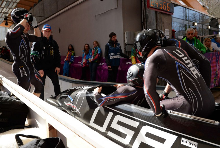 USA-1 four-man bobsleigh, pilot Steven Holcomb, pushman Curtis Tomasevicz, pushman Steven Langton and brakeman Christopher Fogt compete in the bobsled four-man Heat 3. (LEON NEAL/AFP/Getty Images)