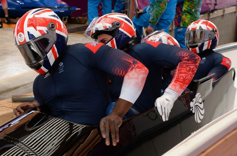 Great Britain-2 four-man bobsled, pilot Lamin Deen, pushman John Baines, pushman Andrew Matthews and brakeman Ben Simons compete in the bobsled four-man Heat 3. (LEON NEAL/AFP/Getty Images)