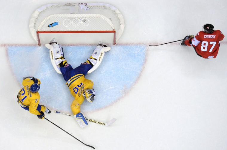 Canada's Sidney Crosby scores on Sweden goalkeeper Henrik Lundqvist. (ALEXANDER NEMENOV/AFP/Getty Images)