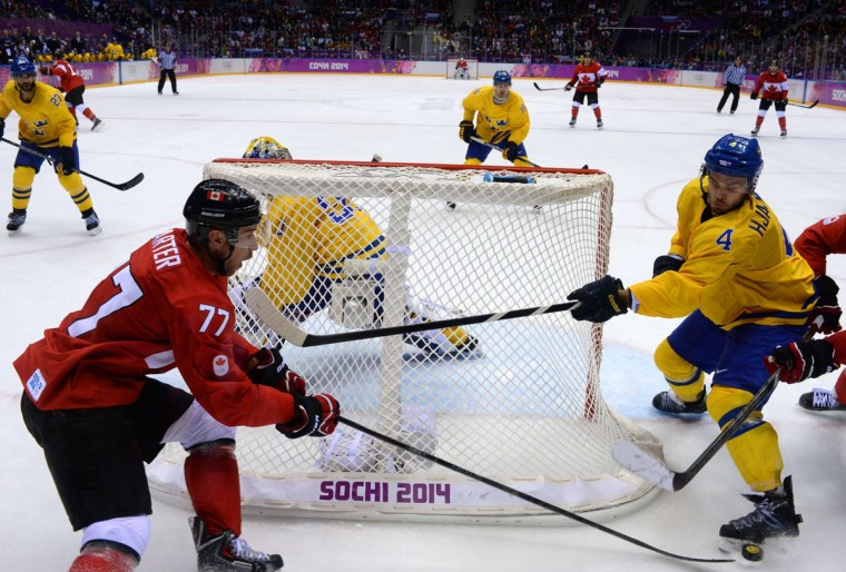 Canada's Jeff Carter (left) vies with Sweden's Niklas Hjalmarsson during the men's ice hockey final. (ANTONIN THUILLIER/AFP/Getty Images)