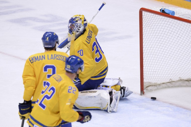 Sweden goalkeeper Henrik Lundqvist fails to stop a goal against Canada. (ALEXANDER NEMENOV/AFP/Getty Images)