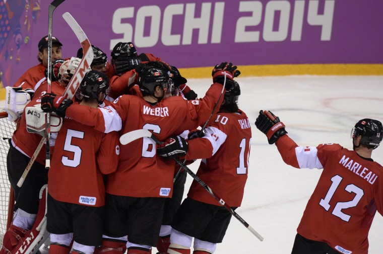 Canada's players celebrate after winning the men's ice hockey final vs. Sweden. (ALEXANDER NEMENOV/AFP/Getty Images)