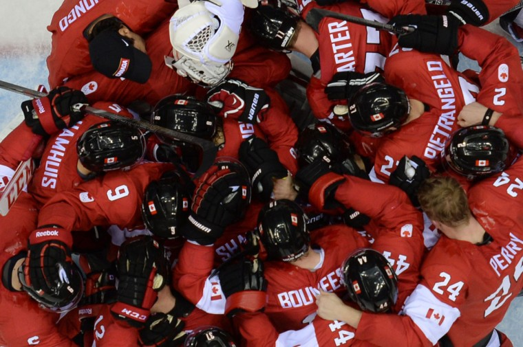 Canada's players celebrate after winning the men's ice hockey final. (ALEXANDER NEMENOV/AFP/Getty Images)