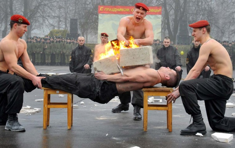 A Belarus Interior Ministry special forces soldier demonstrates his ability to sustain a blow during a competition to mark the Defenders of the Fatherland Day at their training centre outside Minsk, on February 23, 2014. Belarus alongside Russia and other countries of the former USSR celebrates the Soviet holiday on February 23 each year. Following the fall of the Soviet Union in 1991, the holiday was given its current name in 2002 by Russian President Vladimir Putin. (Viktor Drachev/AFP/Getty Images)