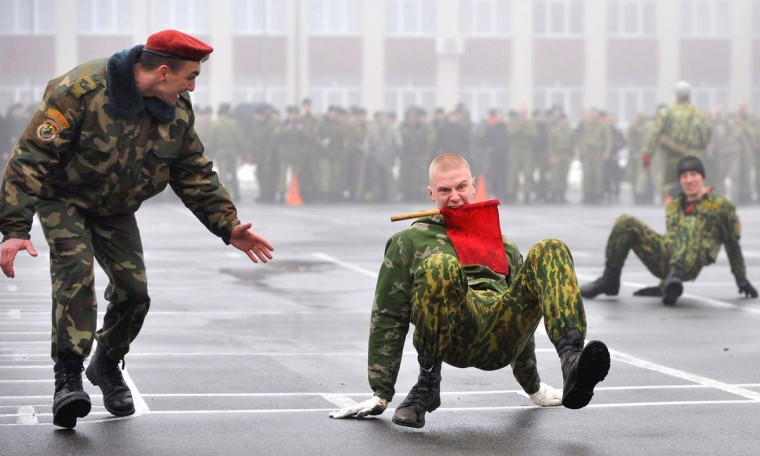 A Belarus Interior Ministry special forces officer encourages his soldier during a competition to mark the Defenders of the Fatherland Day at their training centre outside Minsk, on February 23, 2014. Belarus alongside Russia and other countries of the former USSR celebrates the Soviet holiday on February 23 each year. Following the fall of the Soviet Union in 1991, the holiday was given its current name in 2002 by Russian President Vladimir Putin.(Viktor Drachev/AFP/Getty Images)