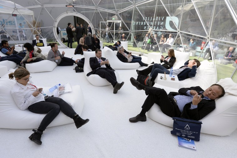 People use their phones in the relaxation area of the 2014 Mobile World Congress in Barcelona on February 25, 2014 The Mobile World Congress runs from the 24 to 27 February where participants and visitors alike can attend conferences, network, discover cutting-edge products and technologies at among the 1,700 exhibitors as well as seek industry opportunities and make deals. (Lluis Gene/AFP/Getty Images)