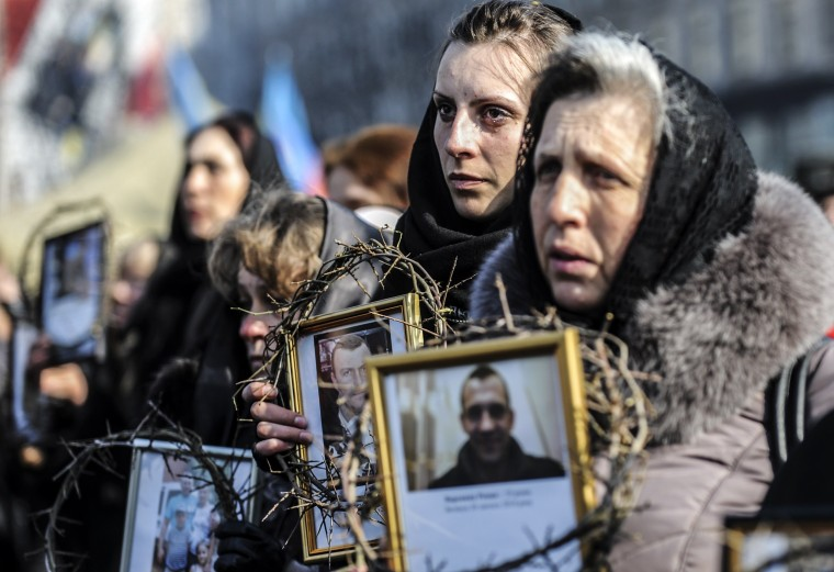 Women hold pictures of protesters who were killed in clashes with police during recent demonstrations as they take part in a commemerative procession in central Kiev on February 26, 2014. Ukraine's pro-Western interim leaders were set to unveil their new cabinet today after disbanding the feared riot police as they sought to build confidence in the splintered and economically ravaged ex-Soviet nation. (Bulent Kilic/Getty Images)