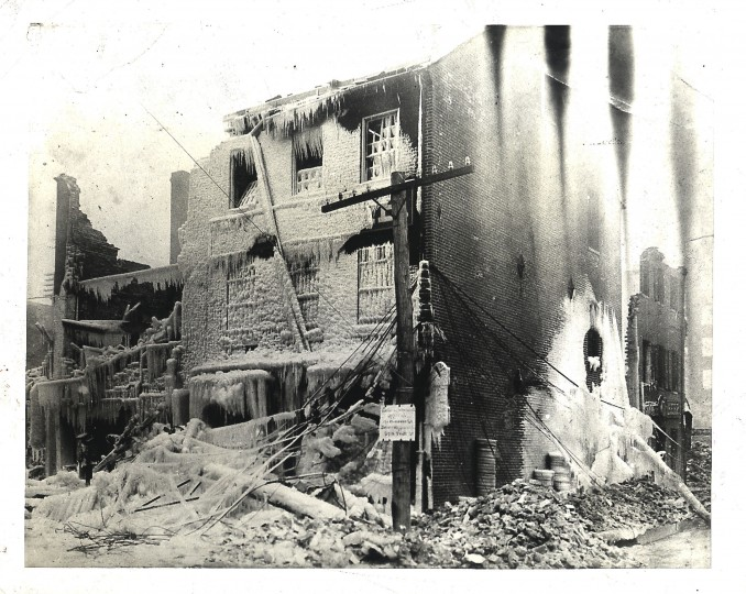 Firemen certainly put the cold finger on this building while they wee fighting our most spectacular blaze back in 1904. And no wonder. It was the Anderson and Ireland hardware store at Light and Pratt streets, and the firefighters knew that there was a whole cellar full of gunpowder, kerosene and other inflammable stuff. So they gave it plenty of water. The freeze followed but the fuel was safe. The picture comes from the collection of J.E.Henry.