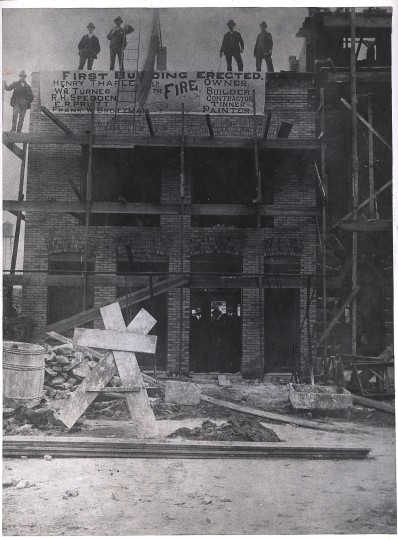 Miss Ethel Taylor preserved this view of the first building going up after the 1904 fire.