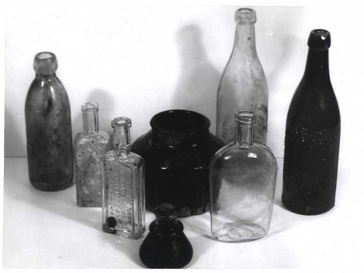 These bottles were uncovered during the excavations for the new office building of south Balto's plant of Koppers Company's metal products division. They date back to the great fire of 1904/ Koppers Advertising Department.