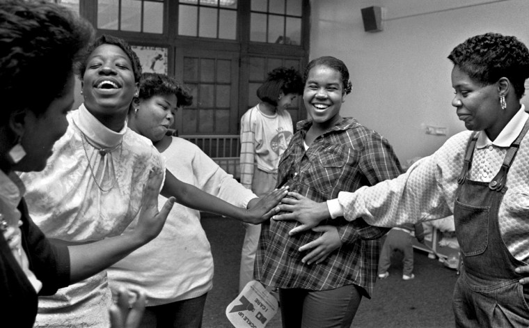 Baltimore, MD - 1988 -- Church members greet Kristin Jones, 13, at a surprise baby shower. I followed Kristin, who became pregnant at age 12, for almost two years for a photo essay on teen pregnancy that ran in The Evening Sun. We were already shooting in color, but I chose to photograph the story in black and white. (Amy Davis / Baltimore Sun)