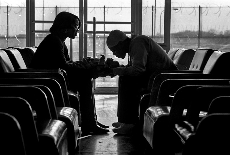 Hagerstown, MD - 1988 -- Kristin Jones brings her baby Dana to the Maryland Correctional Training Center to visit Dana's father, Michael Carter. Michael, 21, was serving a seven year sentence for an assault during a drug deal. Kristin and Michael later married. (Amy Davis / Baltimore Sun)