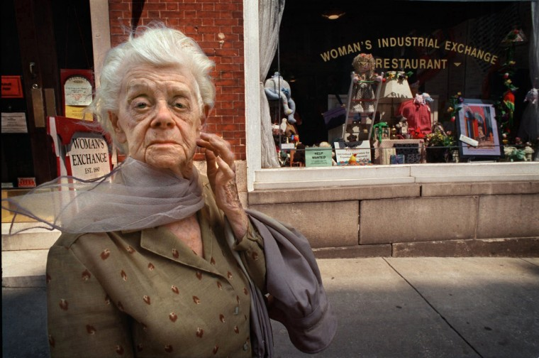 Baltimore, MD - 2000 -- Wilhelmina Godwin, 91, known as Miss Willie, retired this year after about 35 years as guardian of the cupcakes and other sweets in The Woman's Industrial Exchange consignment shop. This portrait was made as she awaited a ride home after another working day. I will always remember Miss Willie quoting poetry as sold baked goods from the consignment shop. (Amy Davis / Baltimore Sun)