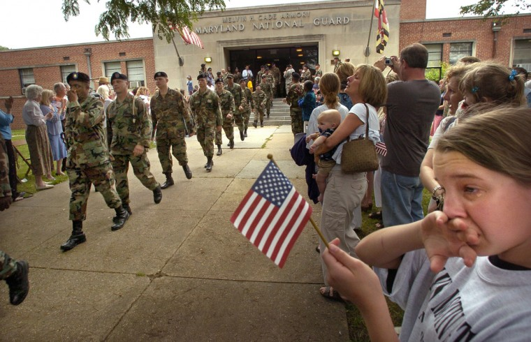 Baltimore, MD - 2005 -- About 170 members of the National Guard's 243rd Engineer Company left Melvin H. Cade Armory in formation, with a large sendoff from family and friends, including tearful Tara Miller, 11, of Severn, at right. She was with her family to say farewell to her step-dad, SGT Thomas Tull. They were headed to Iraq for an 18-month tour, to serve as truck drivers. Amy Davis / Baltimore Sun Staff