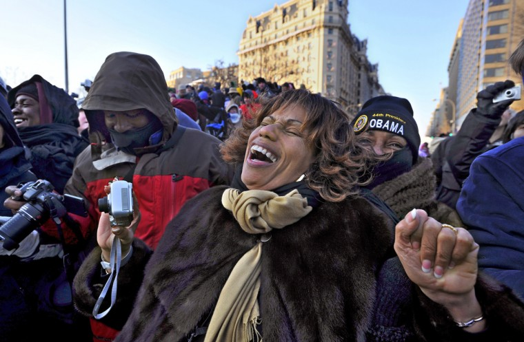Washington, D.C. - 2009 -- Anna Mills, who came from Brentwood, Tennessee to witness the inauguration of the first African-American president, exults with the rest of the crowd on Pennsylvania Avenue near 14th Street, after seeing President Obama wave from the presidential vehicle. Crowds packed Pennsylvania Avenue for the parade after Barack Obama was sworn in as the 44th president. I have covered, mostly from afar, every president since Ronald Reagan. (I worked for The Record in Hackensack back then.) Even though I only glimpsed the President behind tinted glass, this was the most historic presidential moment I have documented. (Amy Davis / Baltimore Sun)