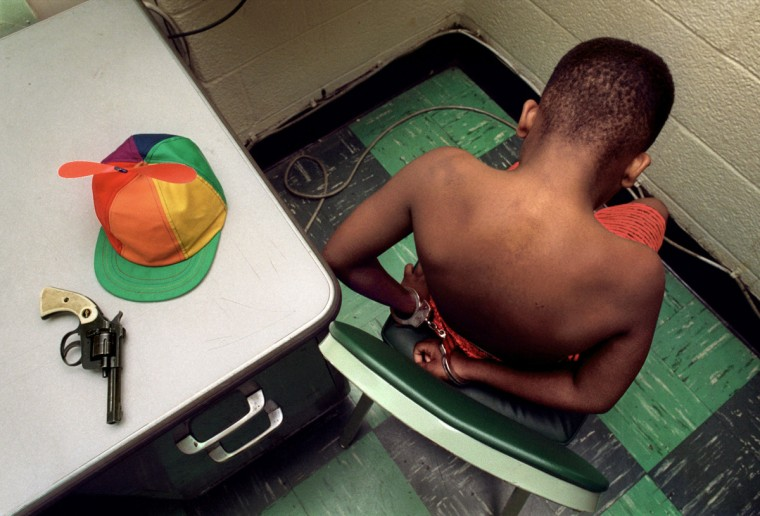 Baltimore, MD - 1991 - The police department notified The Sun of the arrest of a 10-year old with a 22 caliber gun that he used to rob another child of his beanie cap. Even the hardened police were surprised by the age of this juvenile offender. (Amy Davis / Baltimore Sun)