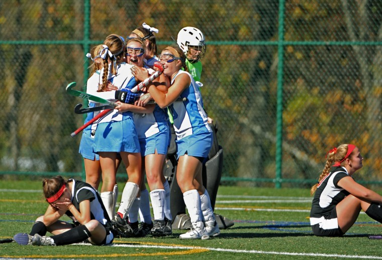 Towson, MD-2013 -- Mount De Sales celebrated their 3-2 win after the second sudden death overtime, as dejected Maryvale players sit nearby. It was the IAAM Field Hockey B-Conference Championship, and the body language of all the girls tells the story that for every joyful victory there is a painful loss. (Amy Davis / Baltimore Sun)