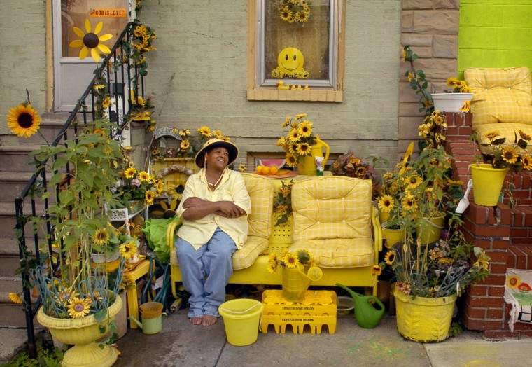 "Baltimore, MD - 2004 - Rita Paul's house caught my eye when I was on another assignment, and I returned to visit her. Her rowhouse on North Wolfe Street was slated to be demolished for a mammoth East Baltimore revitalization project near Johns Hopkins Hospital. Rita had resided on this block for her entire life. She said, ""I don't want to move. Even though it's in the ghetto I still love it."" I kept in touch with her after she was relocated to another street, but she moved again and sadly, I lost track of her. (Amy Davis / Baltimore Sun)"