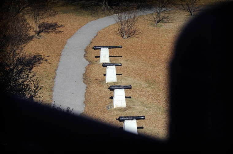 Light highlights a line of cannons located next to the pagoda located in Patterson Park. The row of five cannons represent the War of 1812 fortification at Hampstead Hill, which is now part of Patterson Park. (Barbara Haddock Taylor/Baltimore Sun)