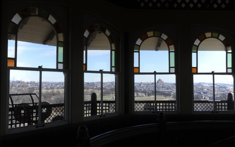 The horizon of Southeast Baltimore peers through the windows from inside on the top floor of the Patterson Park Pagoda. (Barbara Haddock Taylor/Baltimore Sun)
