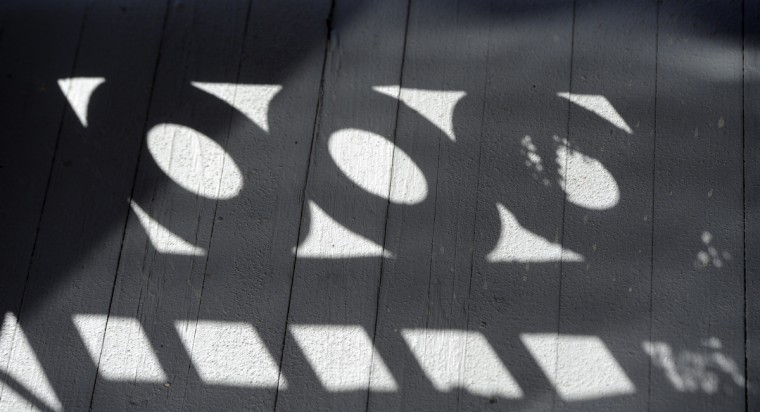 A shadow is cast from the fence around the top floor balcony on the Patterson Park Pagoda. (Barbara Haddock Taylor/Baltimore Sun)