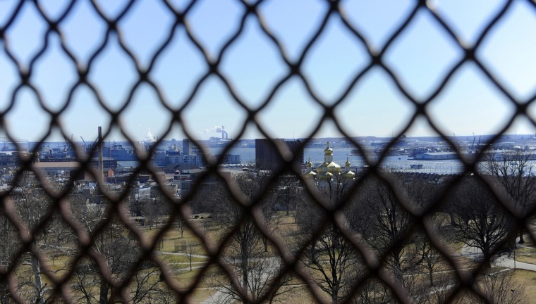 This is a view of Southeast Baltimore's Canton neighborhood on the left and the St. Michael the Archangel Ukranian Church visible through the decorative fence. (Barbara Haddock Taylor/Baltimore Sun)