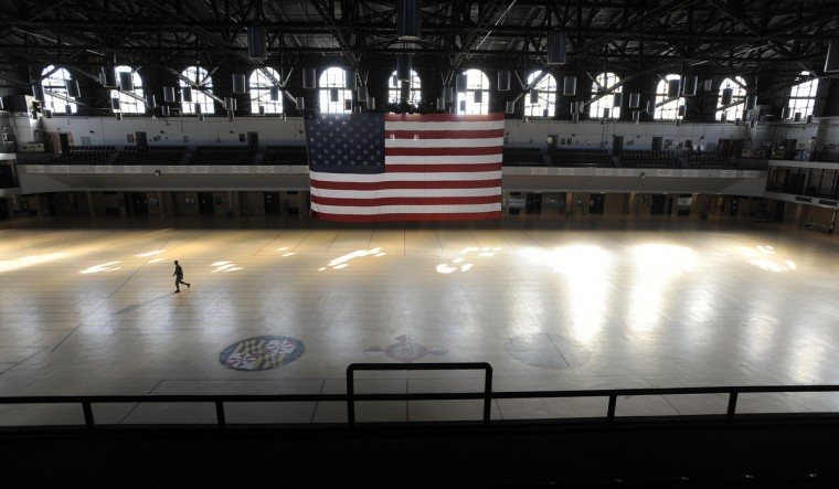 A large American flag hangs in the 200x300 foot drill hall. The Fifth Regiment Armory in Baltimore is a Historic Landmark and one of the oldest armories in the country and is was built for the National Guard. (Lloyd Fox/Baltimore Sun)
