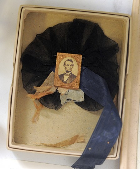 Lincoln Mourning Pin dating back to 1865. One on many artifacts the Fifth Regiment Armory owns. (Lloyd Fox/Baltimore Sun)