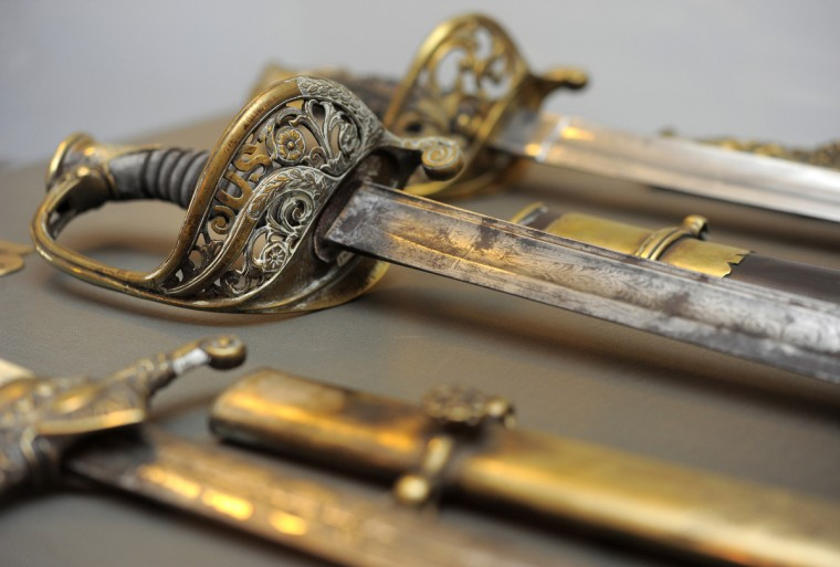 A detail photograph of regimental sabres on display at the 5th Regiment Armory. (Lloyd Fox/Baltimore Sun)