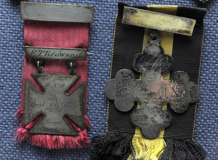 Civil War marksman medals on display in the Fifth Regiment Armory in Baltimore. (Lloyd Fox/Baltimore Sun)