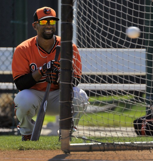 Third baseman Alexi Casilla at the batting cage during workouts at the spring training facility. (Karl Merton Ferron/Baltimore Sun)