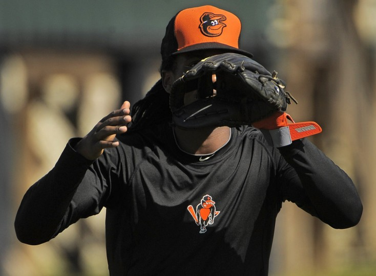 Orioles second baseman Jemile Weeks waits with an open glove for a baseball. (Karl Merton Ferron/Baltimore Sun)