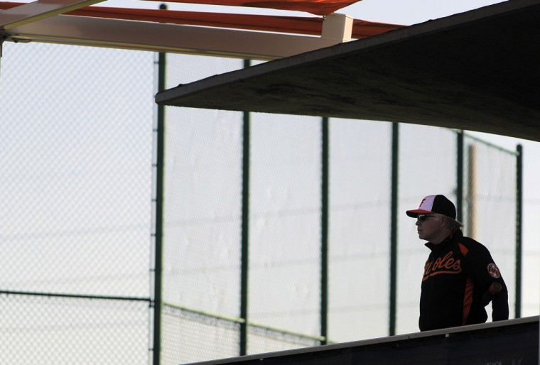 Orioles manager Buck Showalter stands on the observation deck during workouts at the club's spring training facility. (Karl Merton Ferron/Baltimore Sun)