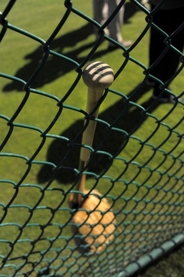 A bat and glove rest against a chain link fence as the Orioles participate during workouts. (Karl Merton Ferron/Baltimore Sun)