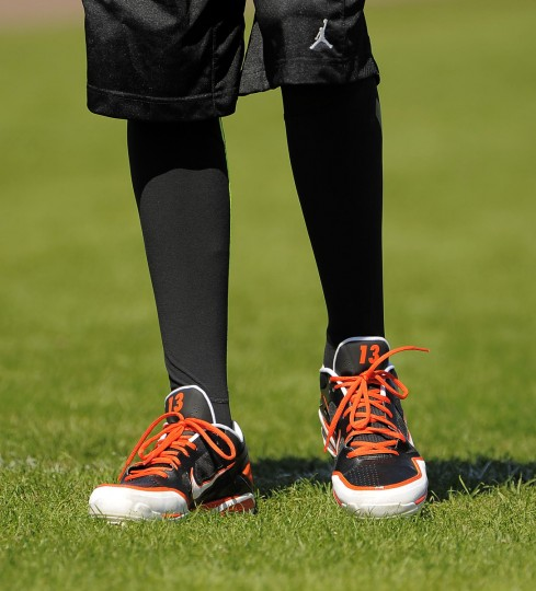 The shoes of Orioles third baseman Manny Machado are pictured on the turf as he sprints following infield grounder workouts at the spring training facility. (Karl Merton Ferron/Baltimore Sun)