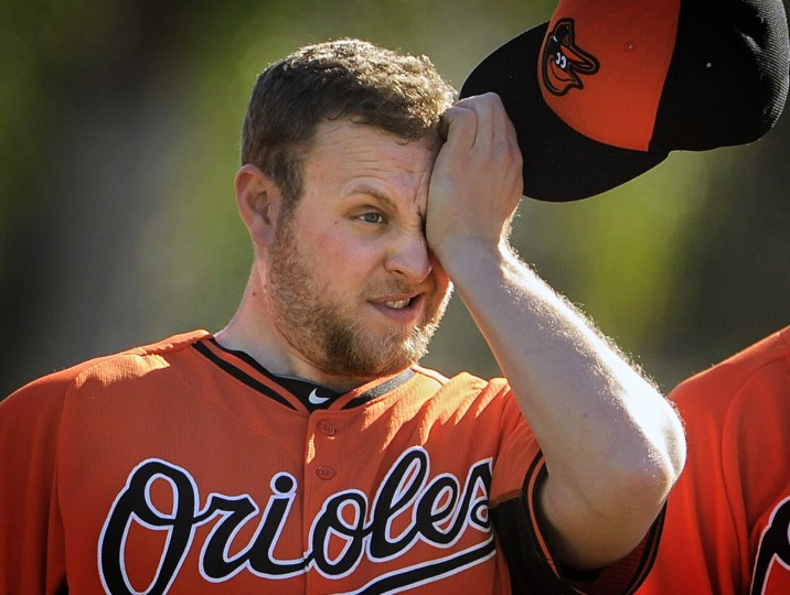 Orioles pitcher Evan Meek wipes his brow as he participates in fielding drills during workouts. (Karl Merton Ferron/Baltimore Sun)