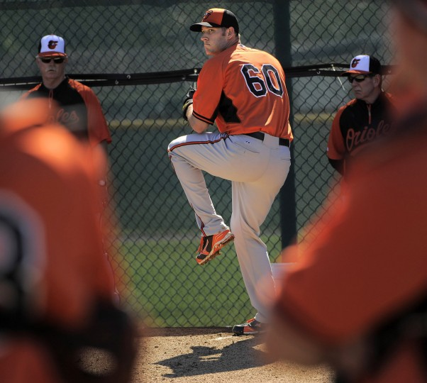 Eyes are on Orioles pitcher Josh Stinson, who throws during workouts. (Karl Merton Ferron/Baltimore Sun)