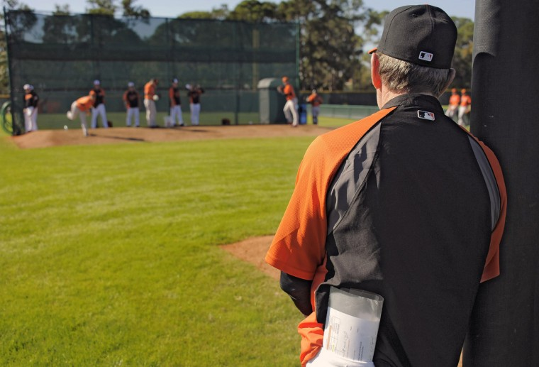 Orioles pitching coach Dave Wallace watches pitchers throw during workouts at the club's spring training facility. (Karl Merton Ferron/Baltimore Sun)