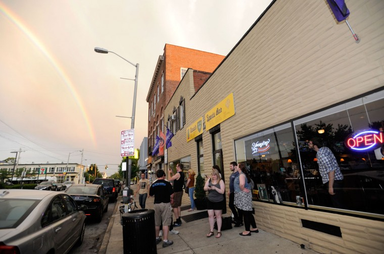 Patrons check out a rainbow outside David's in Hampden June 28, 2013. (Photo by Steve Ruark/The Baltimore Sun)