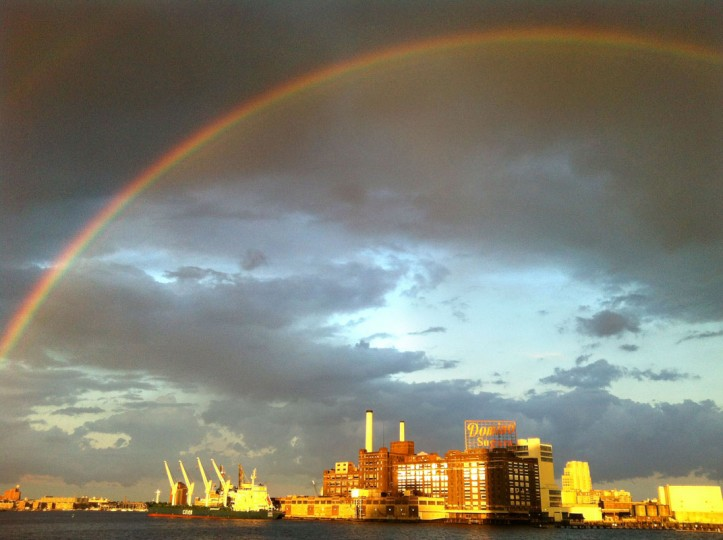 A rainbow is seen over the Domino Sugars sign. (Justin Fenton/Baltimore Sun Staff)