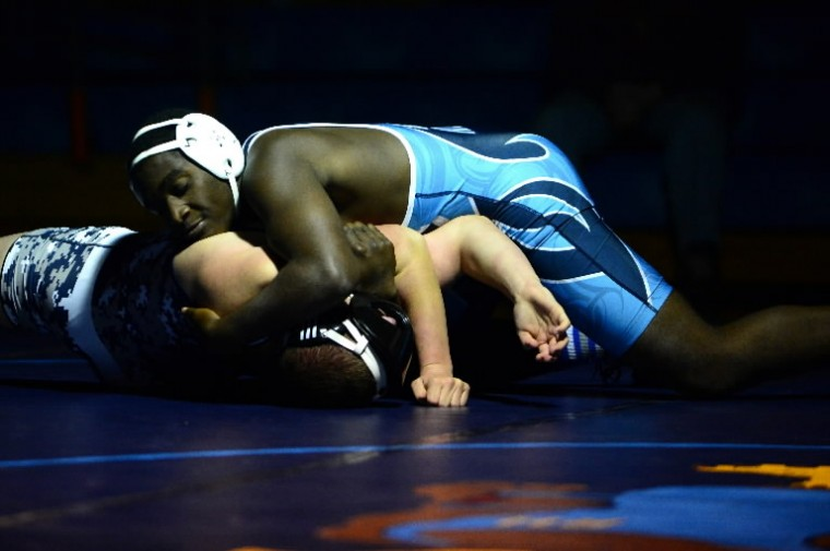 River Hill's Bebe Kum, top, controls Bel Air's Tom Gomez during the 3A/4A East regional wrestling championships at River Hill on Monday, Feb. 17. (Matt Hazlett/BSMG)