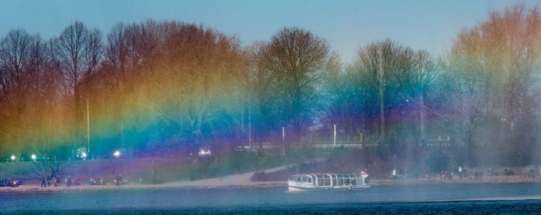 A rainbow is reflected in a fountain on the river Alster, on April 1, 2013, in Hamburg, northern Germany. (Markus Scholz/AFP)