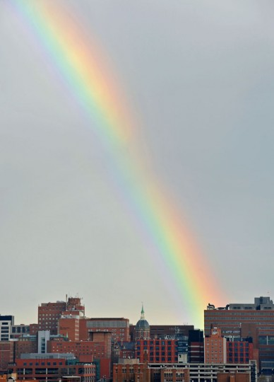 Late afternoon sun showers on New Year's Day, 2012, brought a fleeting rainbow above the Johns Hopkins Hospital campus. (Amy Davis/Baltimore Sun)