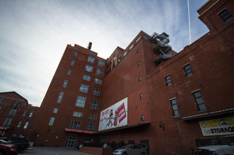 The back-side of the Natty Boh Tower, one of Brewer's Hill's most iconic sights. A neighborhood landmark is the illuminated Mr. Boh sign that hangs high above the old National Bohemian brewery established in 1885. (Kalani Gordon/Baltimore Sun)